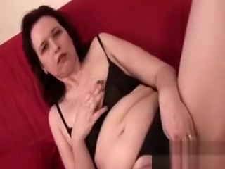 Mature black-haired disrobes undergarments and finger pulverize starved cootchie