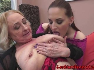 Mature lesbian fingering sweet young pussy