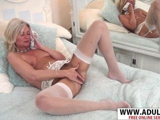 Flat-Chested grandmother kneads Her elderly puss