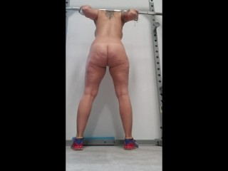'Fit cougar squatting in the gym bare. Powerlifting Motivation, lets go!'