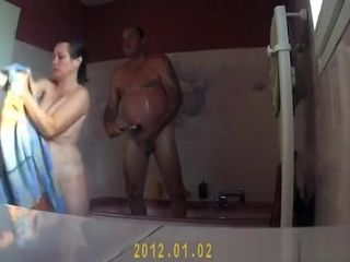 Mature couple showering together