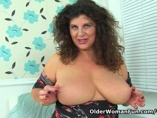 English cougar Gilly pumps her moist muff with a faux-cock