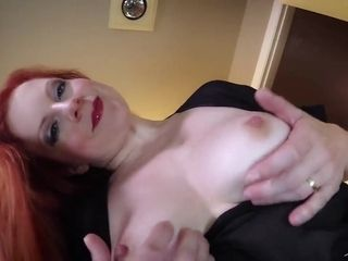 Red-haired mummy demonstrates Her phat breasts