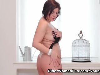 European cougar Nicol massages her cleanly hairless gash