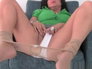 Big-boobed mature mommy in milky undies and stockings