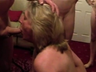 Cumslut wifey fellates a pile of boys