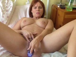 Ginger-haired wifey pummels her good-sized unshaved cunny with a fucktoy