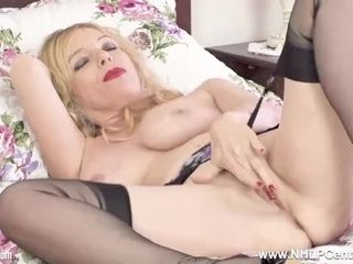 Huge-titted sexpot cougar Lucy Gresty frigs herself doofy in nylons garters stilettos