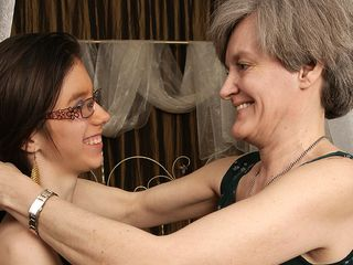 Horny aged and young lesbians go at it