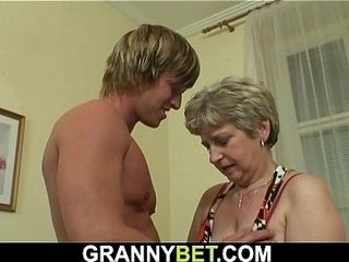 Hot-looking man boinks elder granny on the sofa