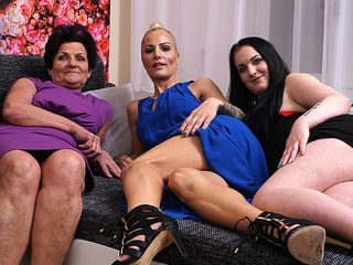 Three senior and young lesbians make out on the bed