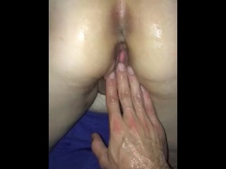 Fisting wife's pussy detach from towards the rear