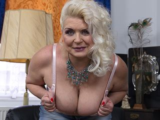 Obese mature breezy showing off her firm mounds
