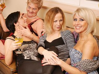 Four older and youthful lesbians have fun on the sofa