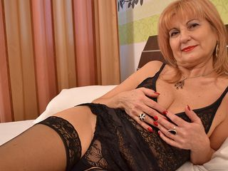 Stylish mature doll getting all super-naughty
