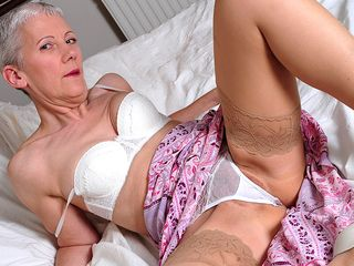 Insane mature whore getting super-naughty on bed