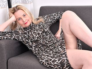 Super-naughty british housewife getting wet and mischievous on her sofa