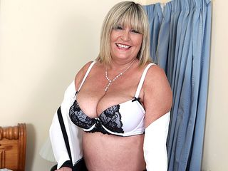 Enormous titted british mature doll playing with her toy