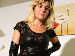 Super-naughty housewife playing with her special toys