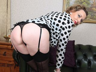 Super-naughty milf playing with her wet slit