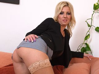 Uber-cute housewife toying with her humid pussy on the sofa