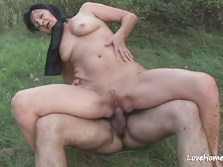 Granny is enjoying automated shagging after a long time into public notice.mp4