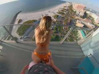 BEACH BUNNY GETS arched OVER A PUBLIC BALCONY & gulps!