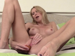 Big-boobed cougar Plays With Her Peach fucktoy