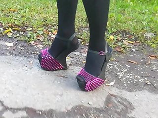 Girl L ambling with exotic extraordinary high stilettos.
